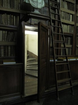 The stacks are accessed by interior spiral staircases located at the four corners of the reading room.