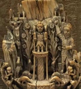 An Angel flanked by a headless Saint Dominic (.l) and Saint John the Baptist.