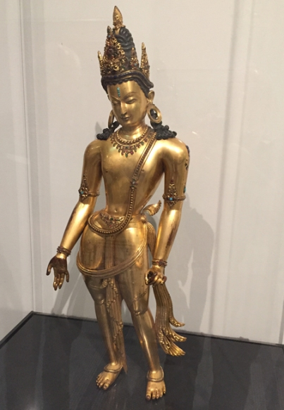 This 14th century Bodhisattva Avalokitesvara in gilt-copper set with precious and semi-precious stones was created by an unknown artist in Nepal.