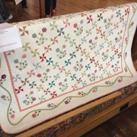 PINWHEELS AND POSIES - hand quilted by Velda Taylor.