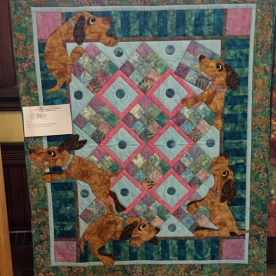 Ruff Around the Edges - Machine quilted and appliqué - unable to read artist's name.